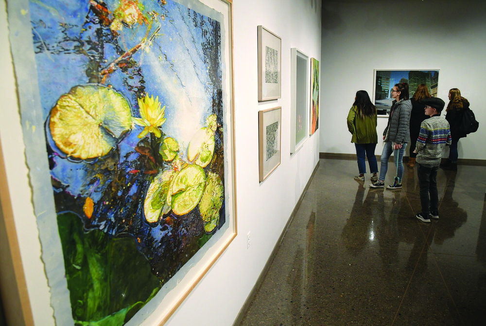 Earth, Air, Fire, Water  displayed varied mediums, including watercolor, acrylics, oil, graphite, and sculpture.