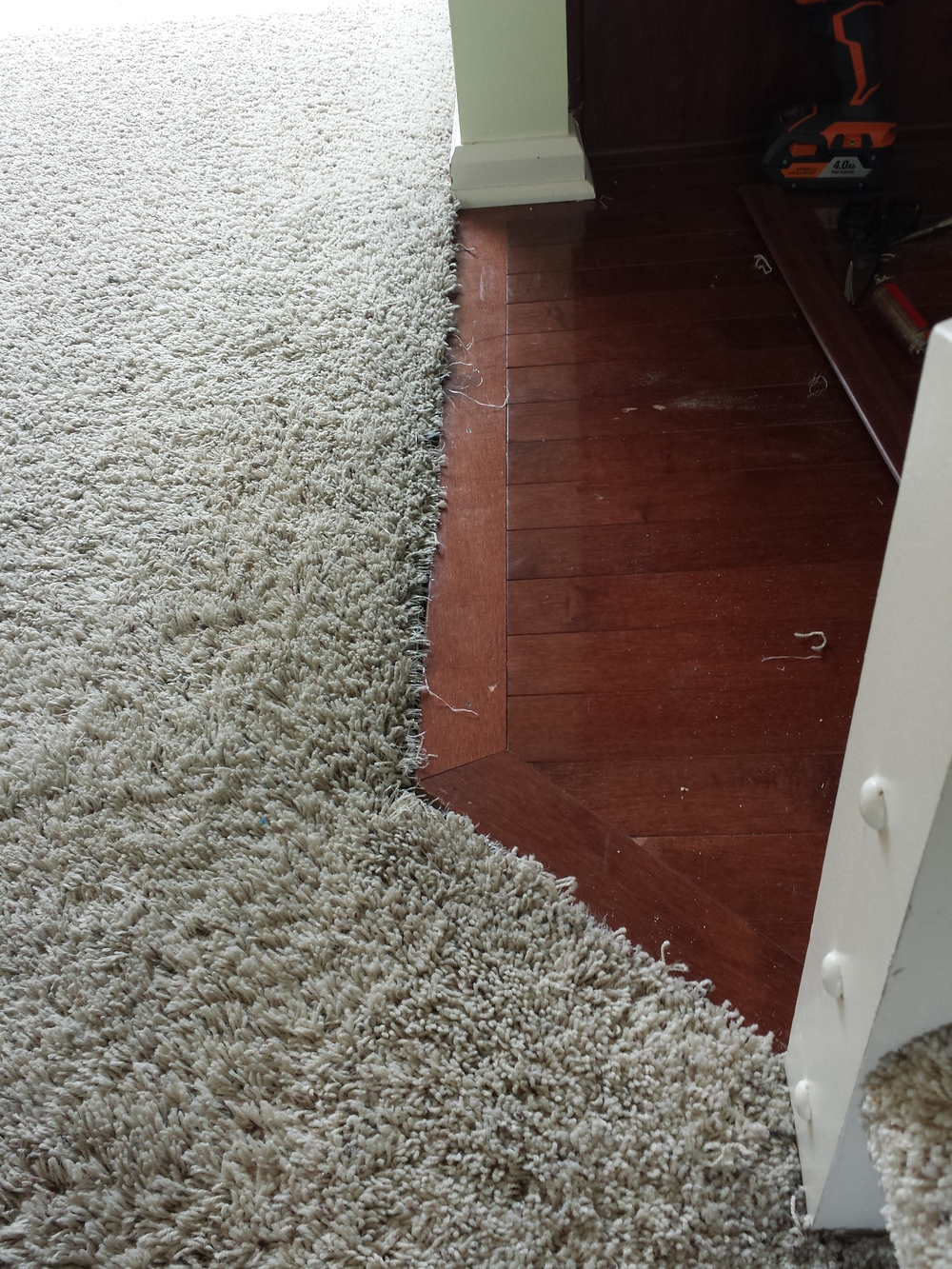 Frayed carpet edge into kitchen