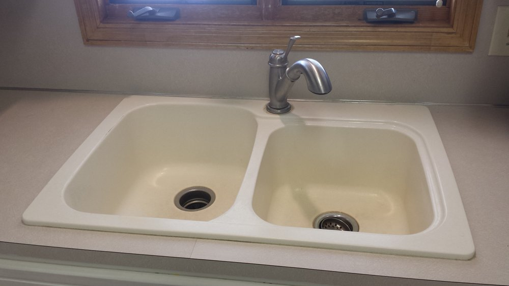 Old enamel sink with faucet