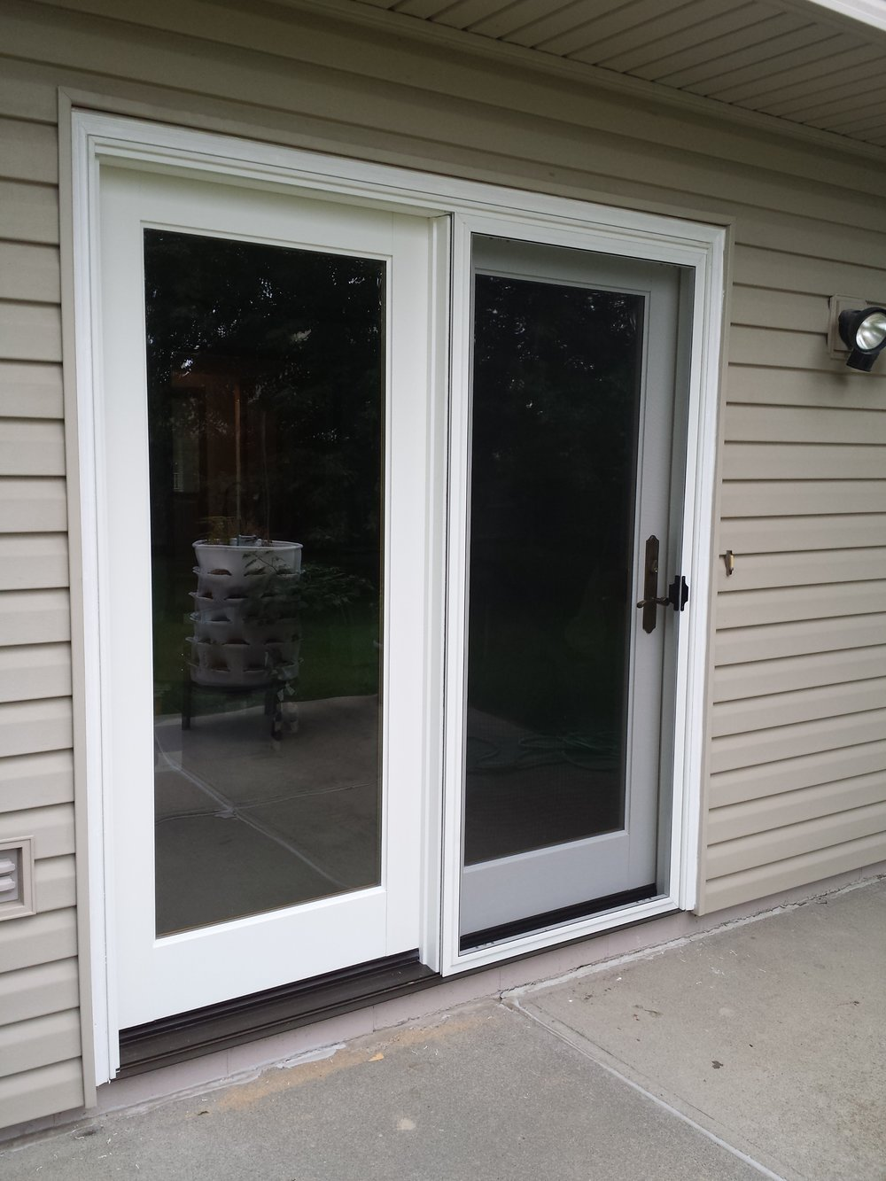 Newly installed patio door with trim