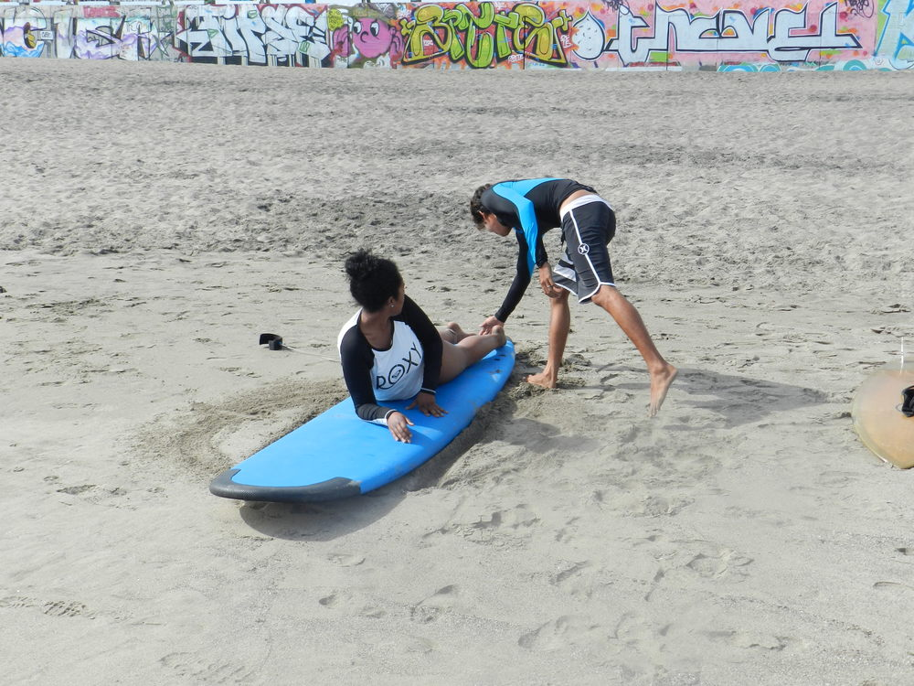 Homie is trying his hardest to teach me to surf...