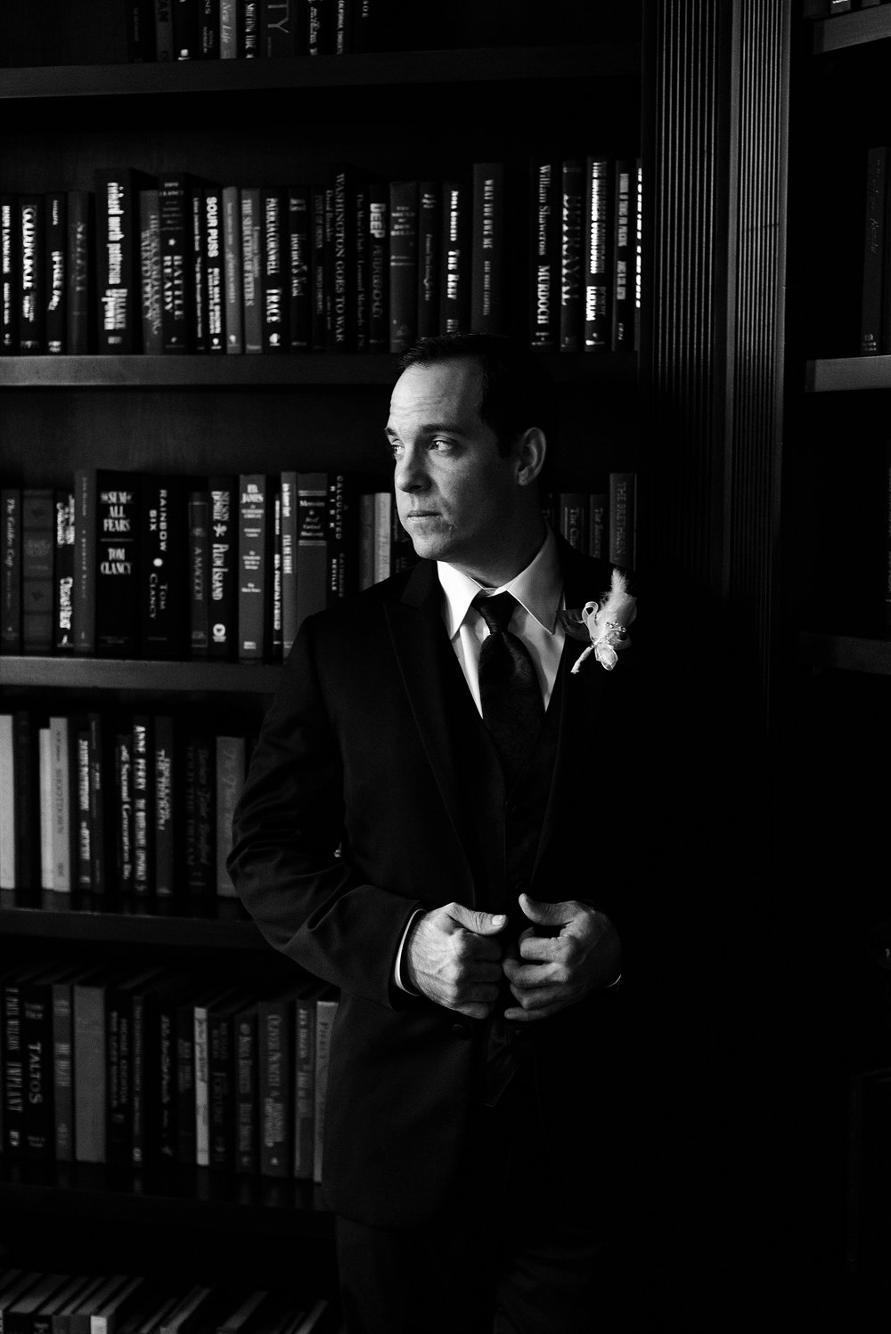 The handsome groom in the library.