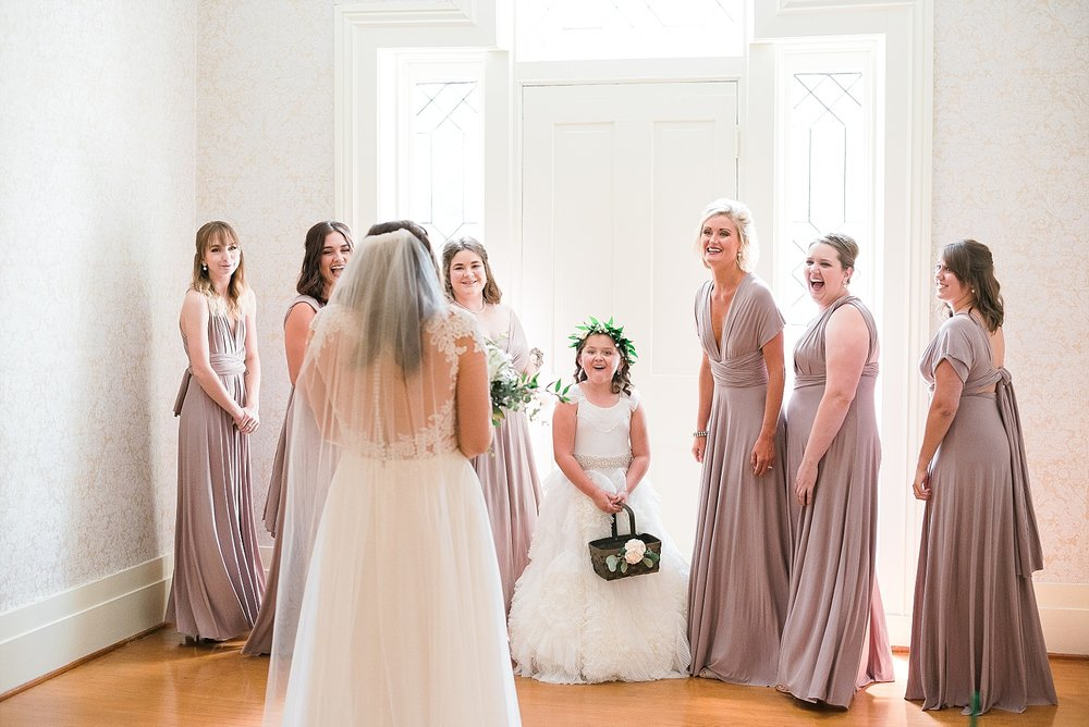 How cute is this?  Love when brides wait to show the girls the full wedding day look!