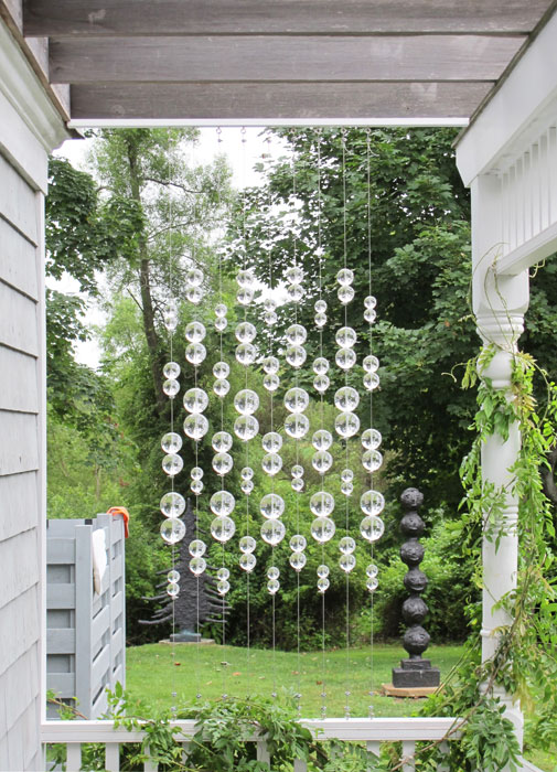 Lisa Beck,  Window Pane , 2012, lucite balls, stainless steel cable and hardware, 38 x 26 x 3 in
