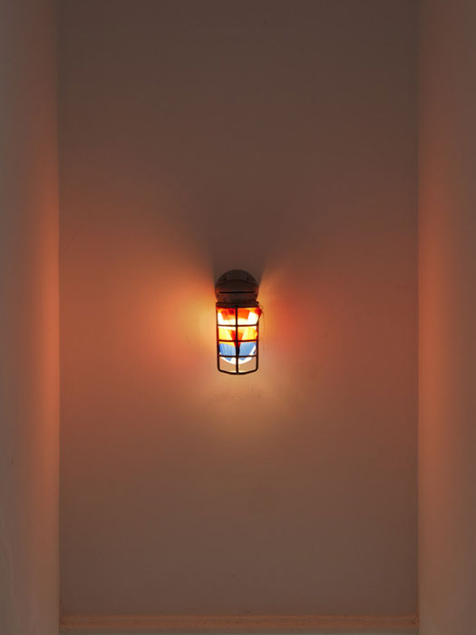 Virginia Overton,  Untitled (Captain America) , 2012, light fixture and fabric, 9 x 6 x 5 in
