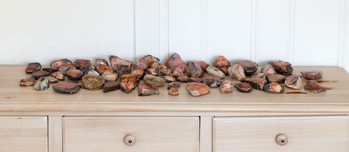 Aura Rosenberg,  Dialectical Porn Rock, Untitled, (Faces Circle #1) , 1989/2012, rocks, magazine clippings, resin, dimensions variable