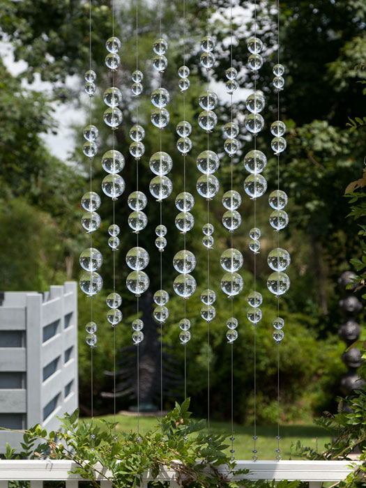 Lisa Beck,  Window Pane  (detail), 2012, lucite balls, stainless steel cable and hardware, 38 x 26 x 3 in