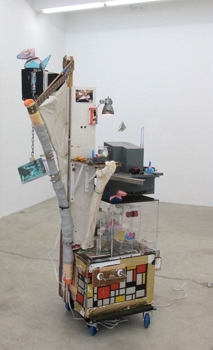 Justin Lieberman,  Storygon Studio , 2012, mixed media including ceramics Porygons, taxidermy crabs, 13 artist books, audio cassettes, CDs, thigh bone of giraffe, electricity, and a painting, 85 x 34 x 45 in