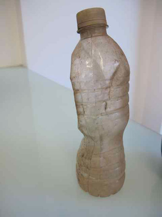 Ryan Foerster and Ben Schumacher,  Piss bottle,  2012, unidentified liquid, dirt, dimensions variable