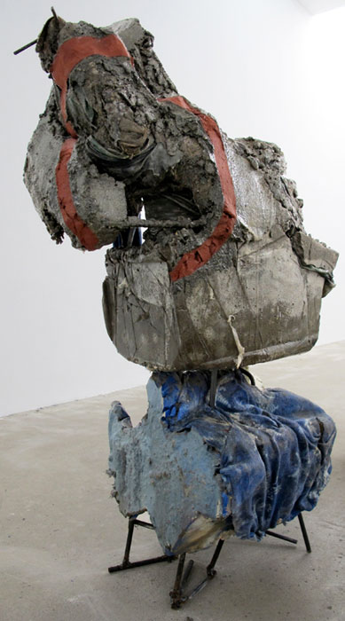 Jo Nigoghossian,  Flakes, aka Blockie , 2011, cast concrete, steel, snowflake fleece, sari, spray paint, house paint, burlap, resin, 56 x 20 x 27 in
