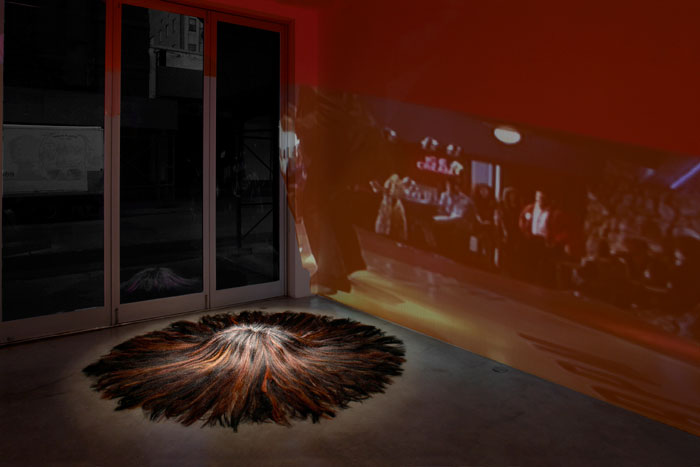 Curtis Mitchell,  Pulp Fiction (detail),  2009, video installation, hair (pillow), car seat, dimensions variable