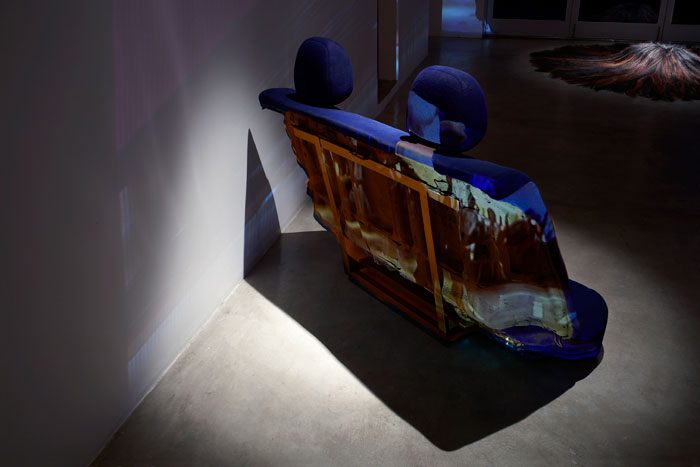 Curtis Mitchell,  Pulp Fiction (detsil),  2009, video installation, hair (pillow), car seat, dimensions variable