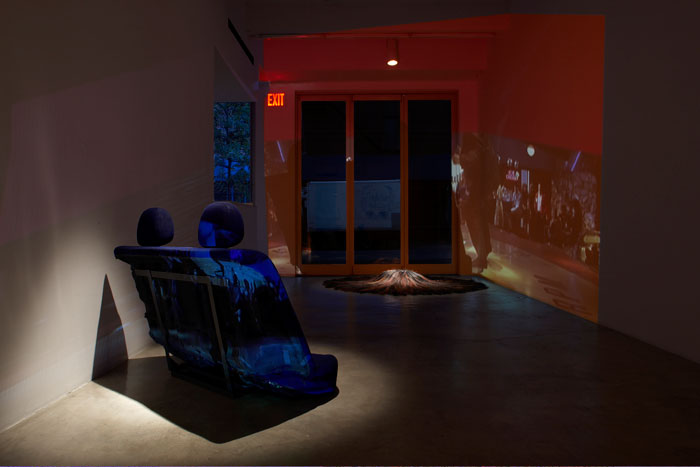 Curtis Mitchell,  Pulp Fiction,  2009, video installation, hair (pillow), car seat, dimensions variable