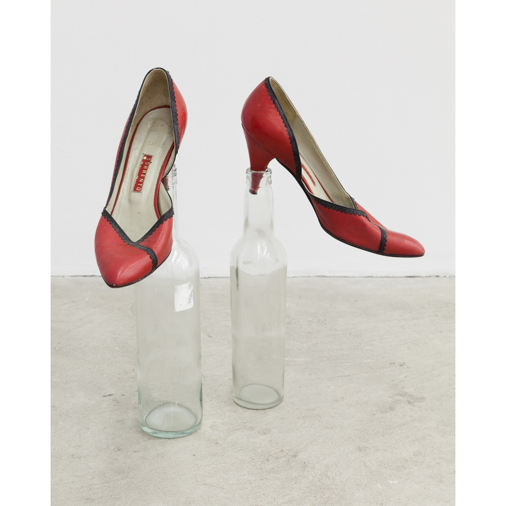 Martin Soto Climent,  Poking Shoes , 2007, women's shoes, two glass bottles, dimensions variable