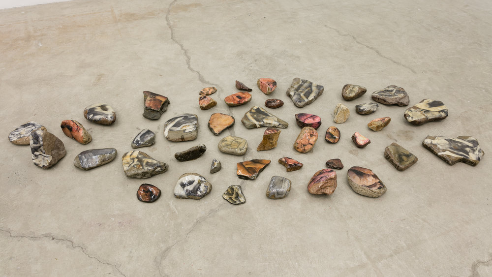Aura Rosenberg,  Dialectical Porn Rocks,  1989-2016, rocks, newspaper, xerox, resin, dimensions variable