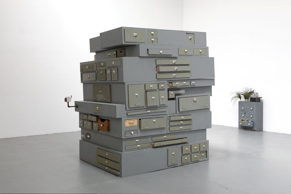 Justin Lieberman,  That Part of My Life is Over 2,  2012, wooden sculpture with archive, dimensions variable;  Bunker Oasis,  2011, 53 x 39 x 32 in.
