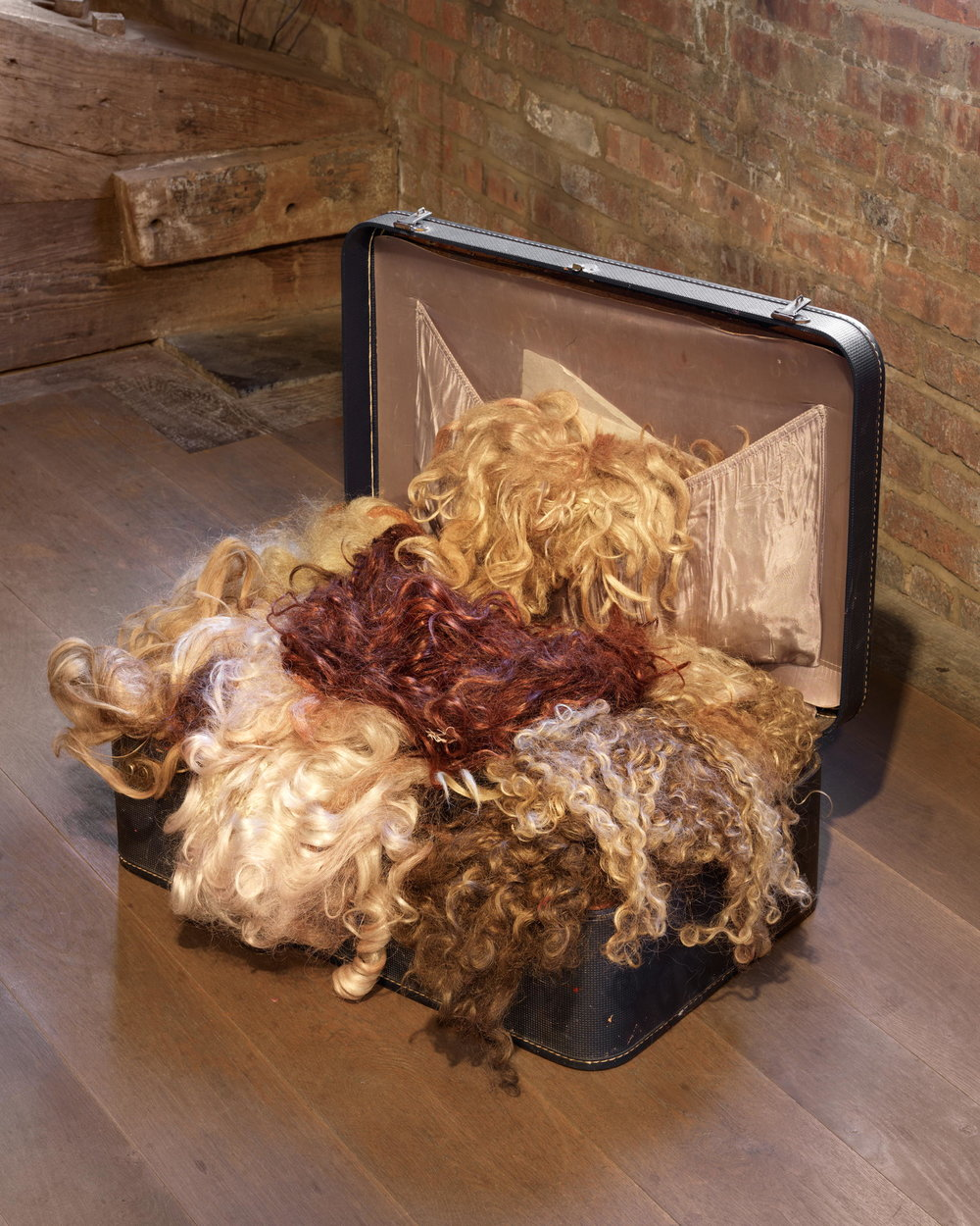 Kathleen White,    Wig suitcase , c. 1990s, suitcase, wigs, Dimensions variable