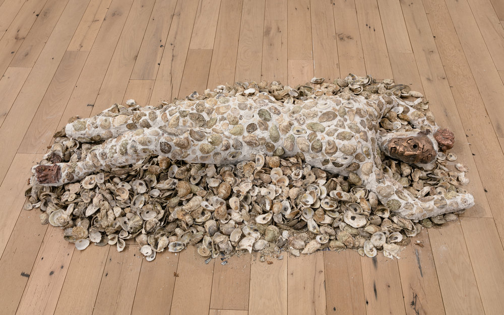 Jory Rabinovitz,  Death of Abel , 2018, tabby, melted pennies and oyster shells, Dimensions variable
