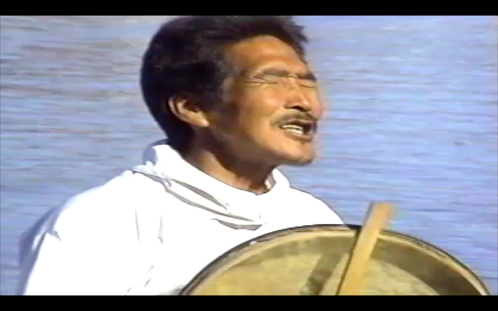 Dan Asher,  fishing song, greenland , 1997, VHS tape to digital video, color, sound, 5:05 min.