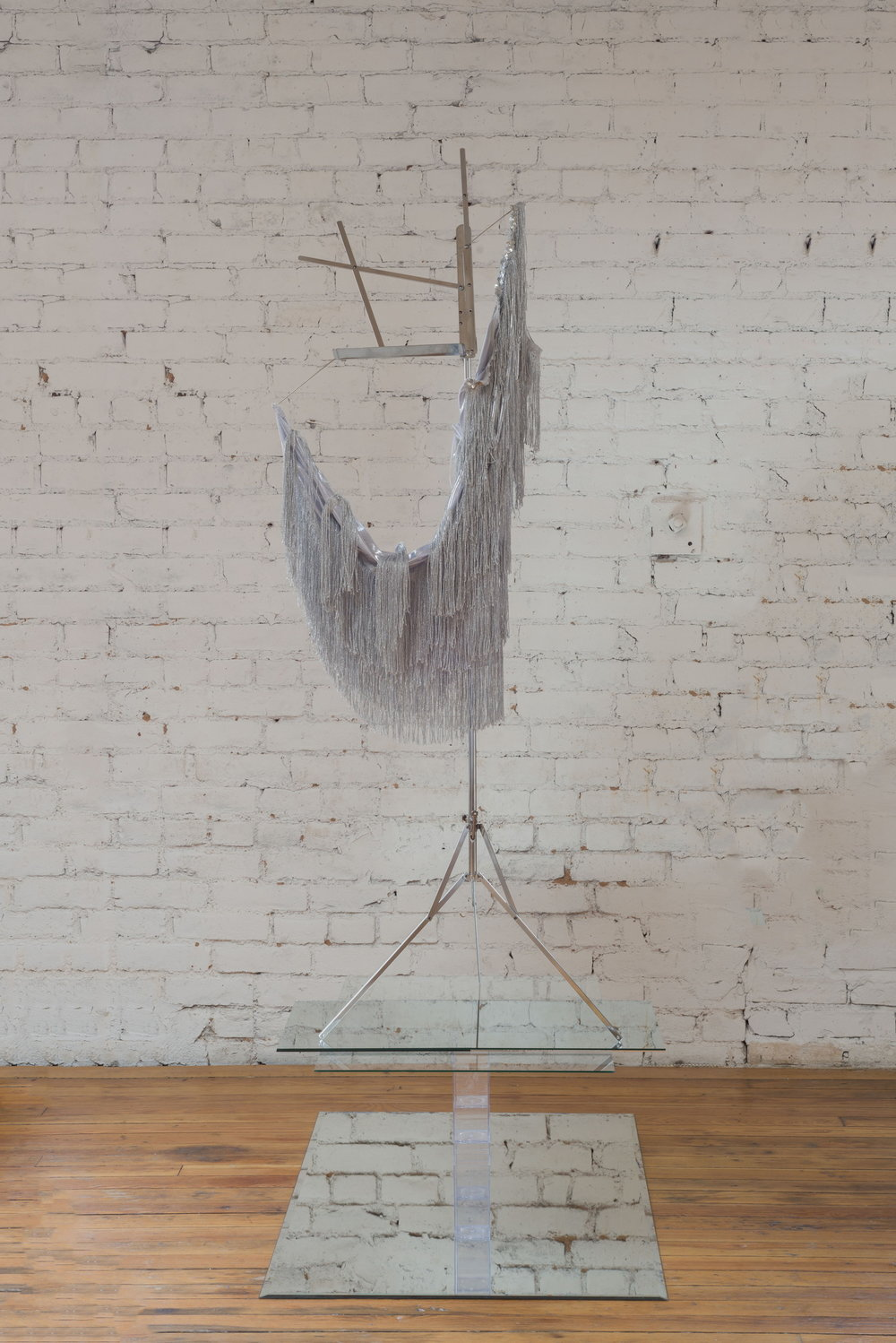 Kayode Ojo,  Untitled (from Trigger, 2014) , 2017, Dazzling Silver Womens Flapper Costume Size Large, Hamilton Stands KB400 Classic American Folding Sheet Music Stand (Chrome), Clear Amac Boxes, mirror, glass, Dimensions variable.