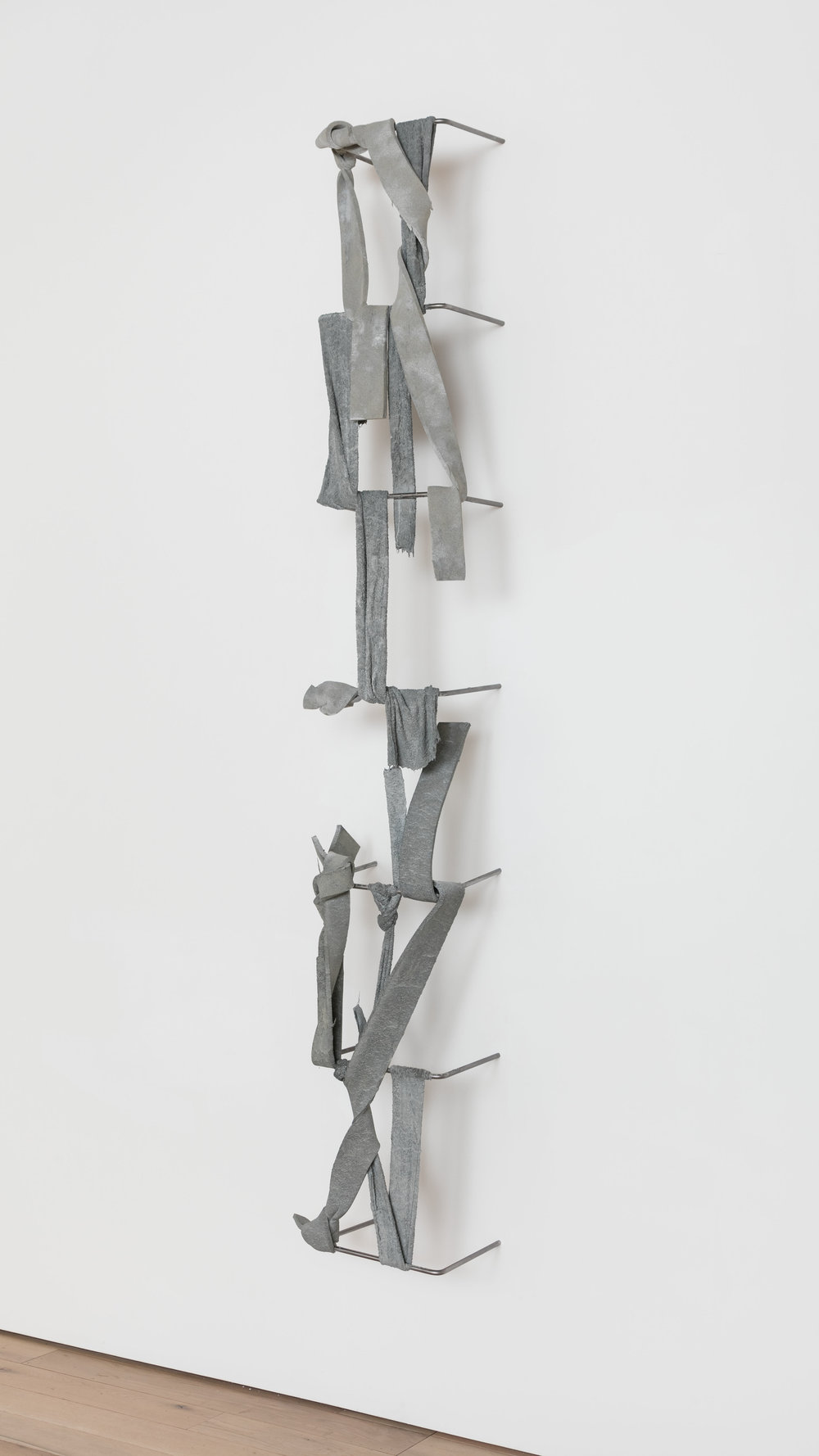 Nikita Gale,  FIXED LOOP III-IV , 2018, concrete, polyurethane foam, terrycloth, steel, 115 × 18 × 13 in.