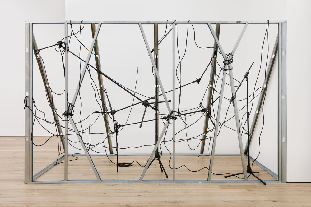 Nikita Gale,  INTERCEPTOR , 2019, mic stands, cables, metal studs, 85 x 138 x 89 in.