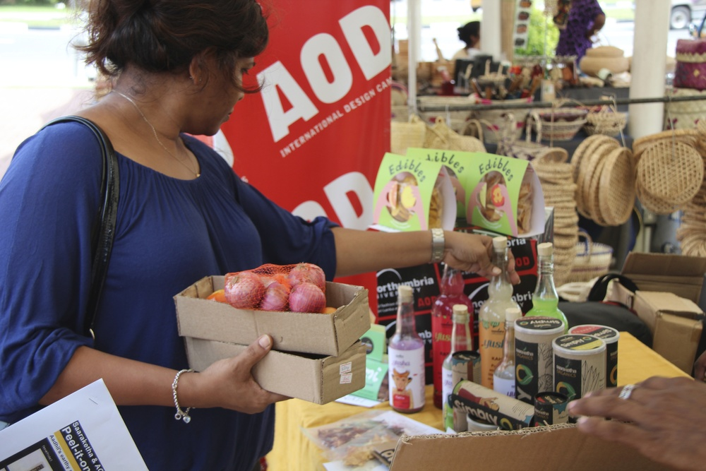 Customers of organics brand Saaraketha give feedback on student packaging concepts for a line of organic snacks and smoothies at a fair trade market in Colombo. 2014.