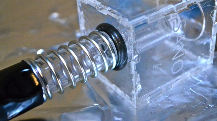 AUTOMATIC 100ML WATER DISPENSER   The chemistry team  identified a need to build a automatic, handheld 100mL dispenser for chemistry experiments. The dispensor has two states - one in which the spring is uncompressed and the top hole was open to be filled from a jar above, and the second when the user compressed the spring, releasing the o-ring seal at the bottom and dispensing water through the hollow tube.