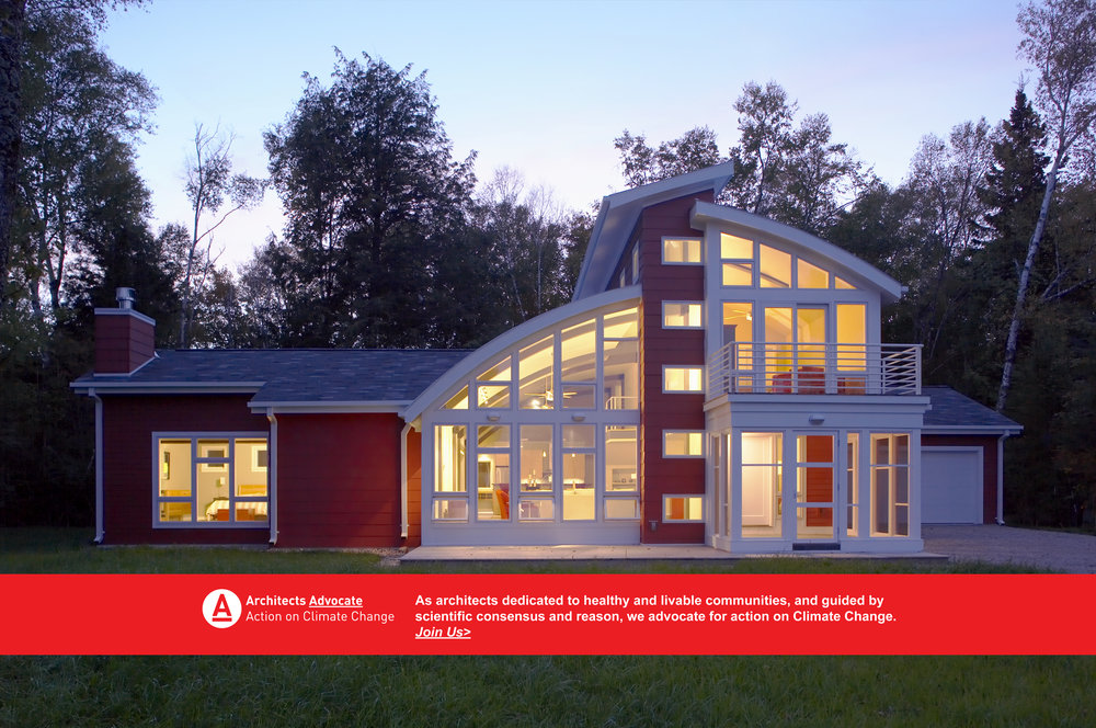 Architects Advocate: Action on Climate Change   Vernacular vacation home Sturgeon bay Wisconsin Kipnis architecture + planning   sustainable adaptive design  award winning  barneco-friendly  energy efficient  FAIA    green  green building  Midwest  midwest barn  natural daylighting  natural ventilation  night   red    standing seam metal roof