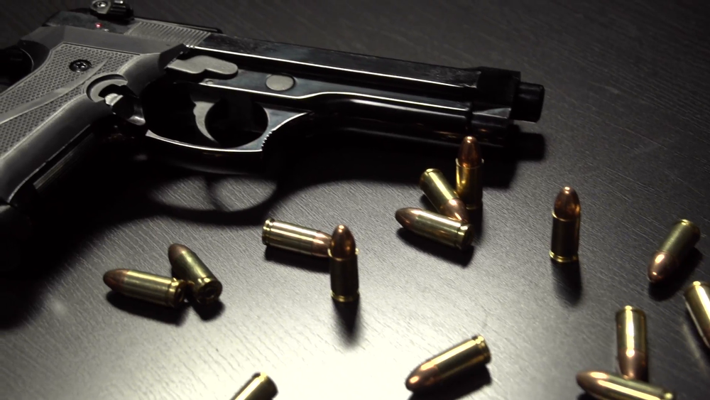 bullets-and-guns-on-a-table-dolly-shot_ejbnde7n__F0006.png