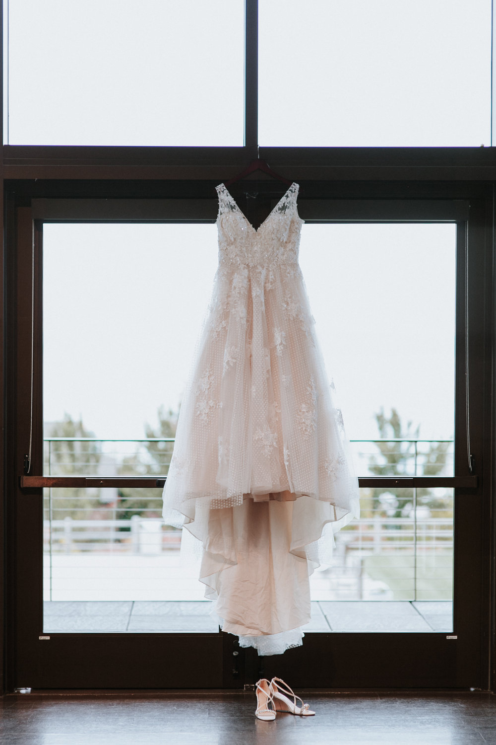 Lace wedding dress and shoes hanging