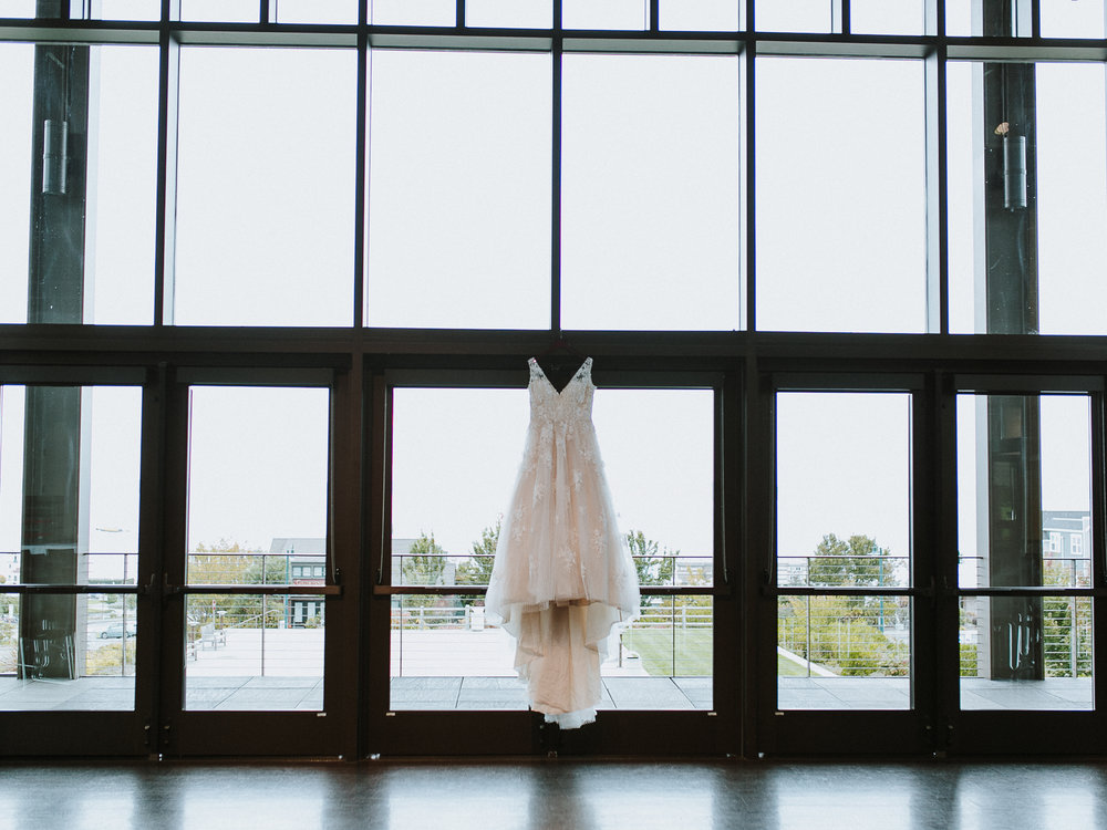lace wedding dress hanging rosehill community center
