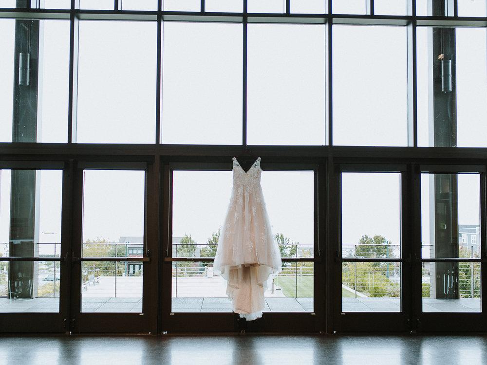 lace wedding dress hanging rosehill community center