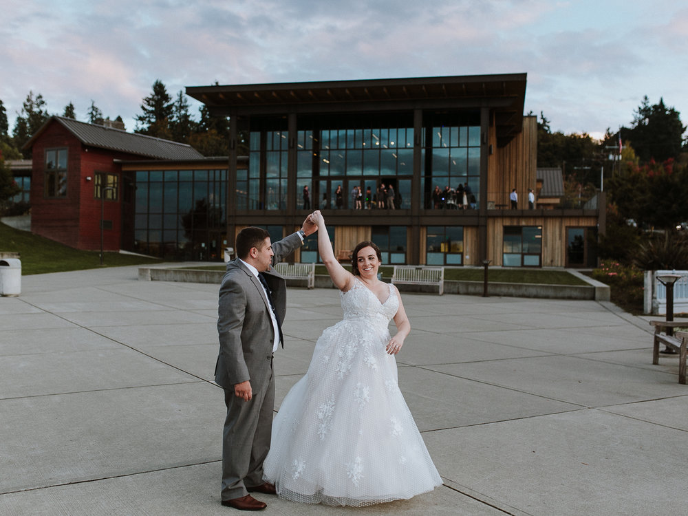Seattle bride twirling with groom