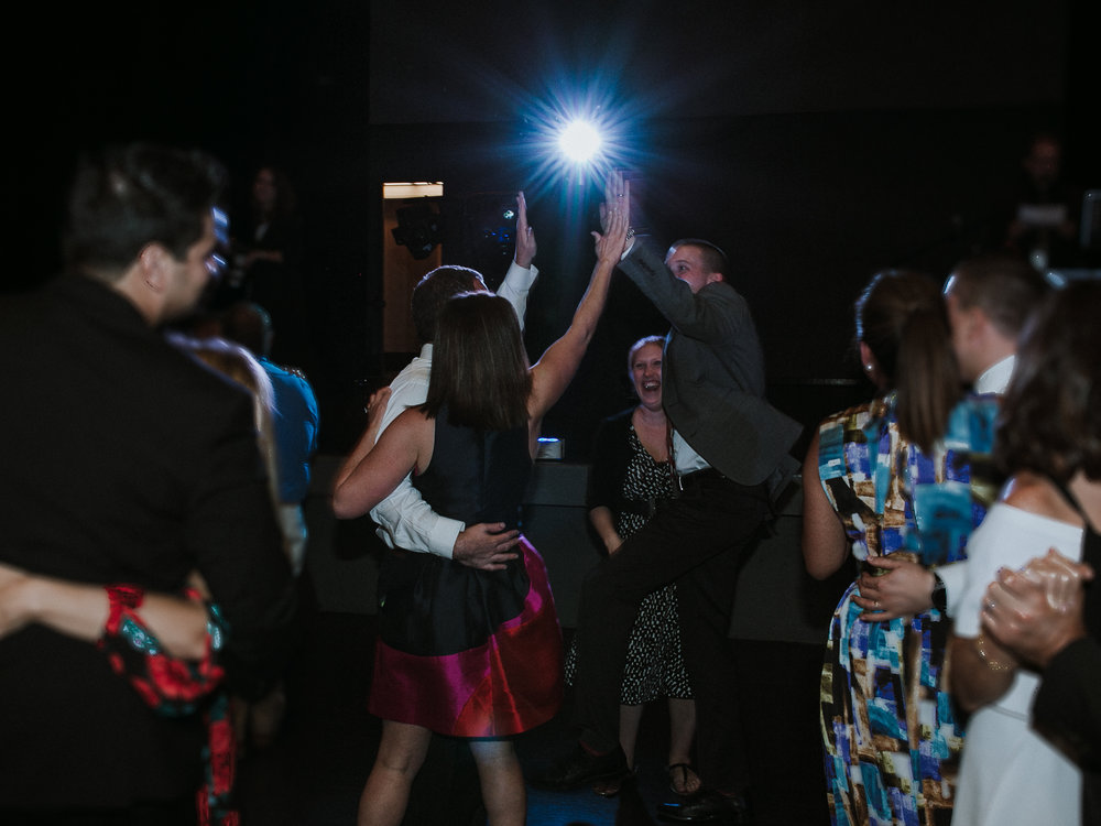 reception dancing high five