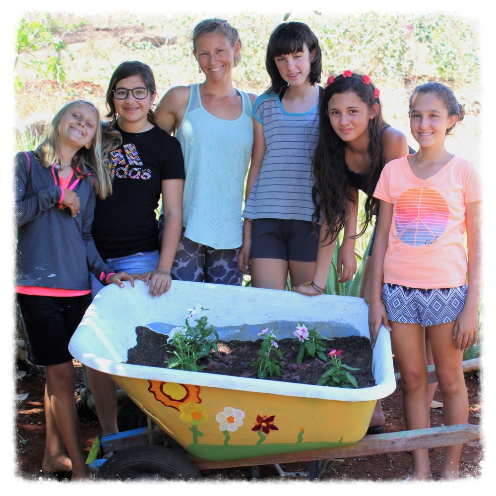 Teagan and these Radiant Girls pause for a photo opportunity while working on a community service project that brought beauty to Iwalani's Healing Garden in Ewa Beach, Hawaii.