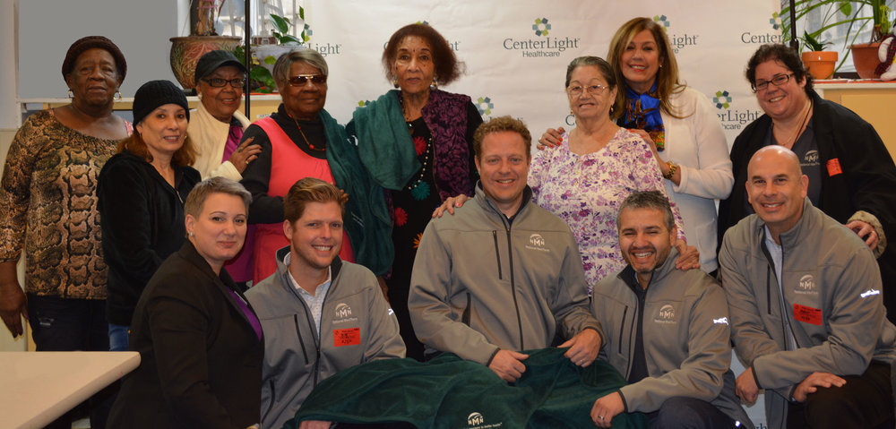 Celebrating with CenterLight Healthcare PACE members at a National MedTrans sponsored NMN Cares event.  NMN executive leadership team in light gray jackets (left to right): Billy McKee (President), Steve Wilson (CXO), Alejandro Vargas (COO), and Andrew Winakor (CEO).  Also pictured: CenterLight leadership, NMN managers and various plan members.