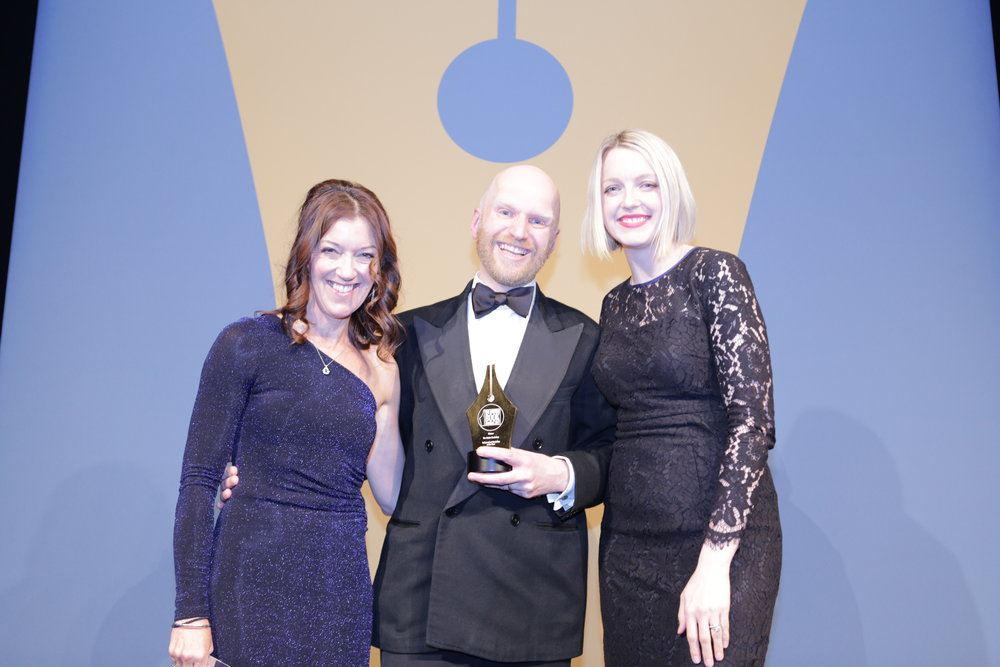Shop owner Bob Johnston with Victoria Hislop (left) and ceremony host Lauren Laverne (right)