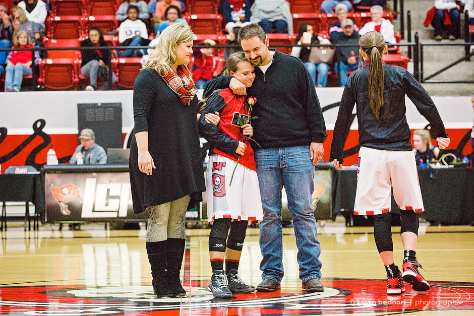 Sweet Addi Fuller with her mom and Dad.