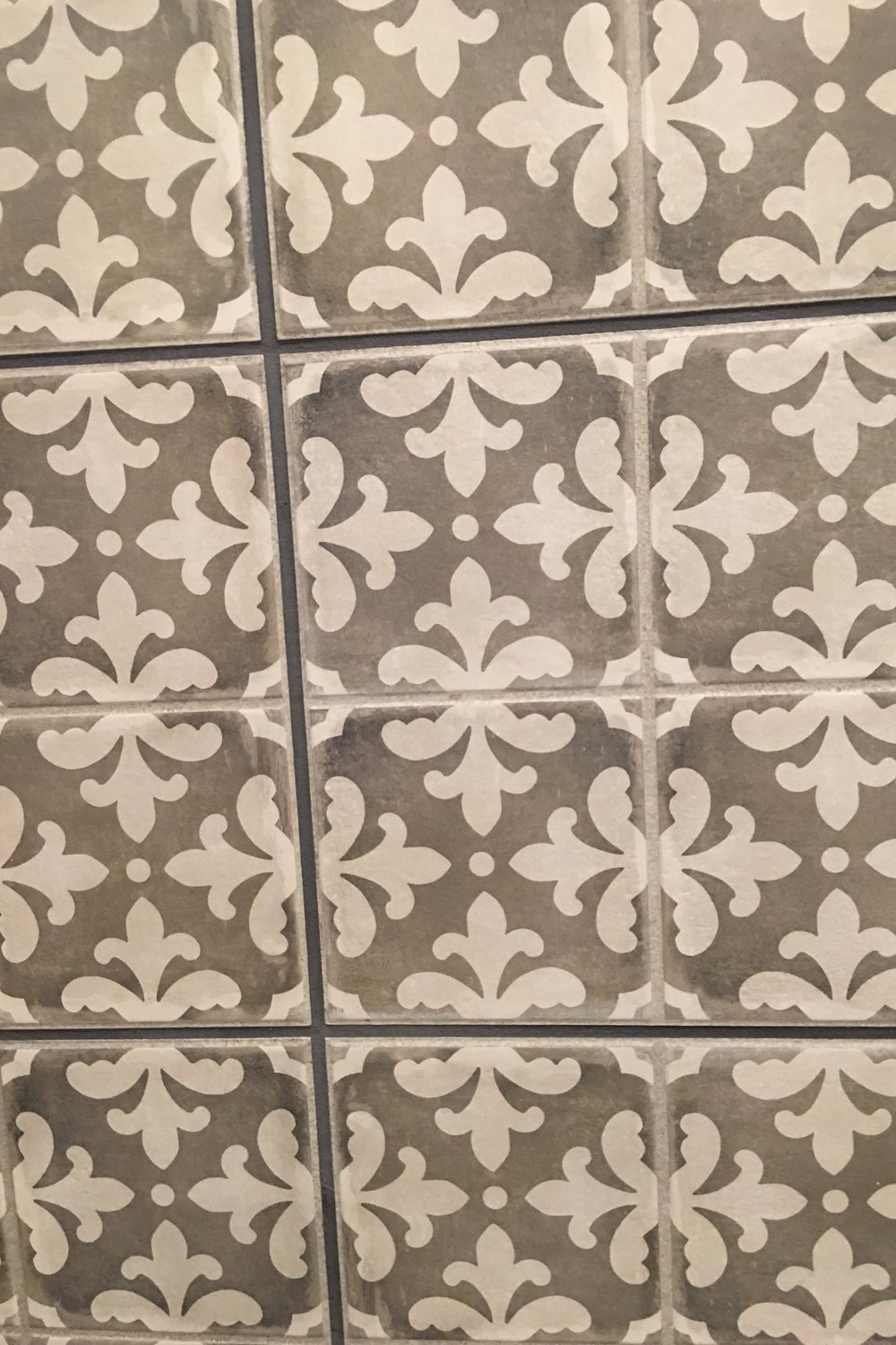 Lots of patterned tile was used in the homes.  Many were a muted grey, but several were high contrast and even painted.