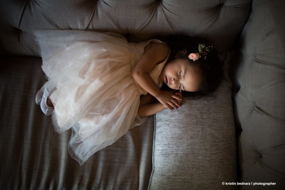 Worn out!  Being a flower girl is rough and tough.  Being a flower girl at your momma's wedding?  Even tougher.  This girl crashed shortly after cake.  LOL