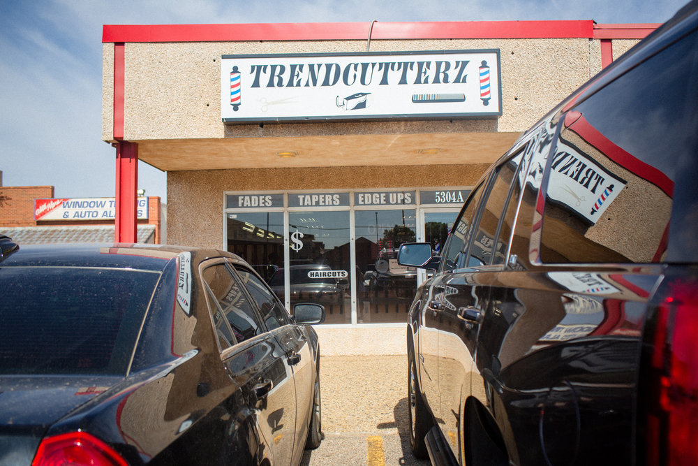 BJ had plans that morning to get spiffy at his local barber shop, Trenscutterz.  They h ave a cool street feel, almost like a car shop or pit stop.  From the lighting to the hair blower, super cool.
