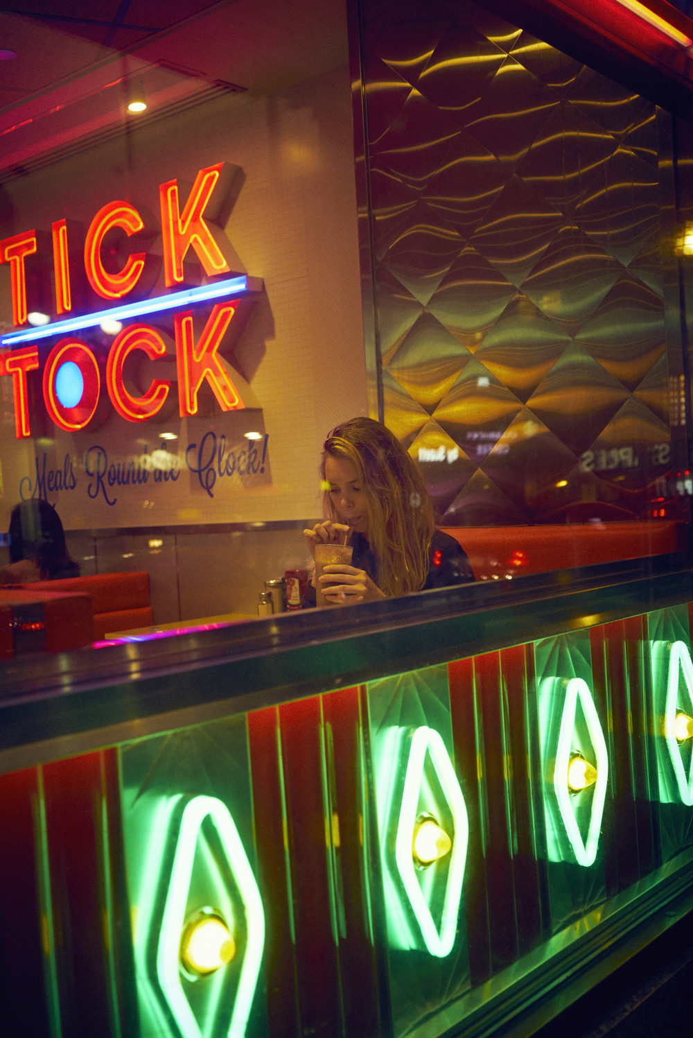 Girl drinking milkshake at Tick Tock Diner.jpg