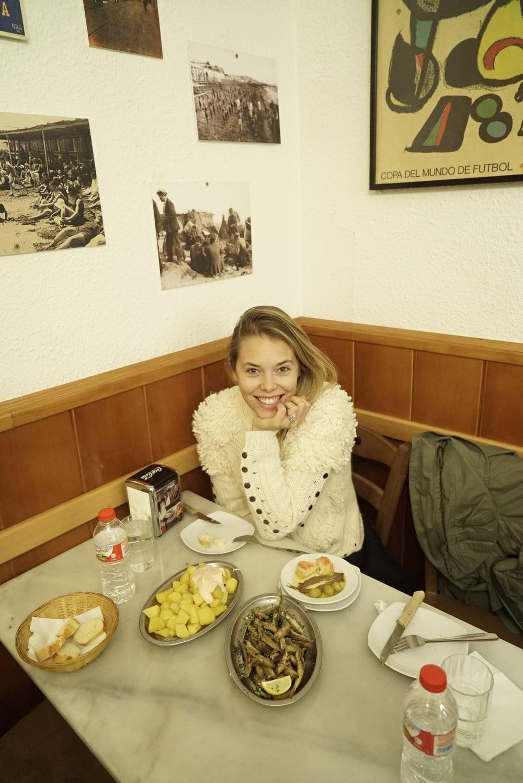 Girl eating at Taverna Iberia.jpg