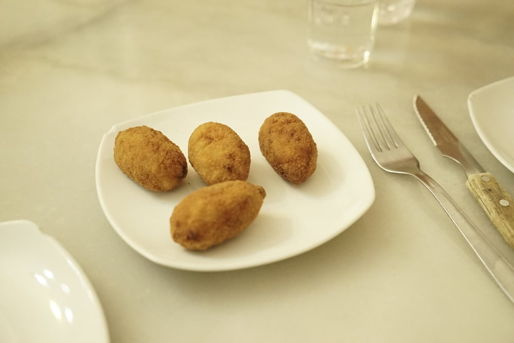 Croquettes on a white plate.jpg