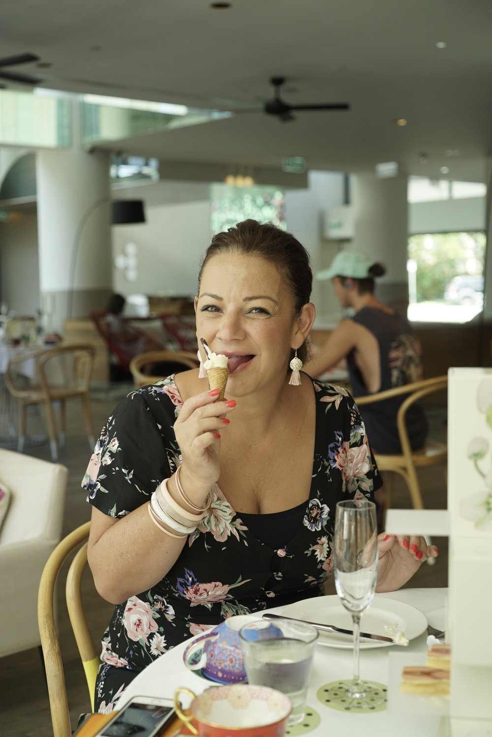 gina licking her scone cone Qtea high tea gold coast.JPG