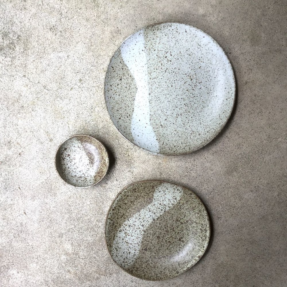 536 Two speckled plates and condiment top.jpg