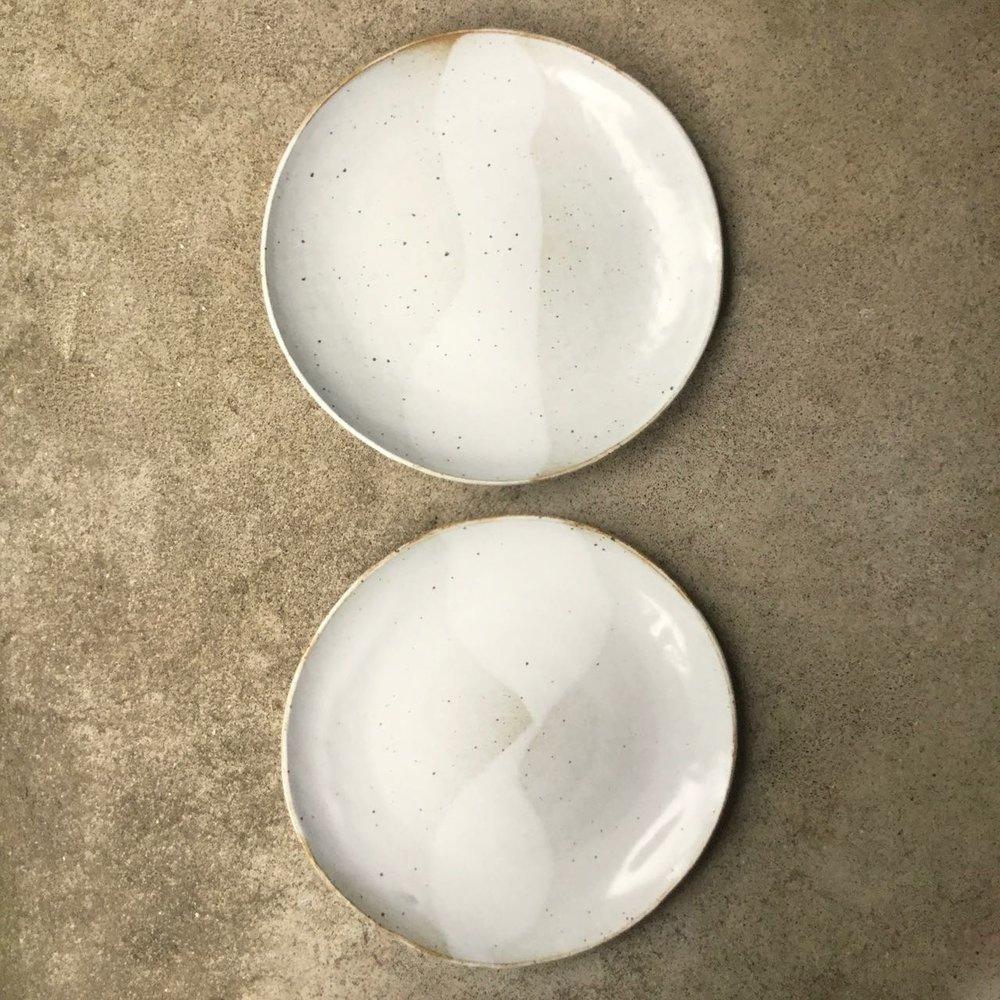 943 Pair glossy white dinner plates top.jpg