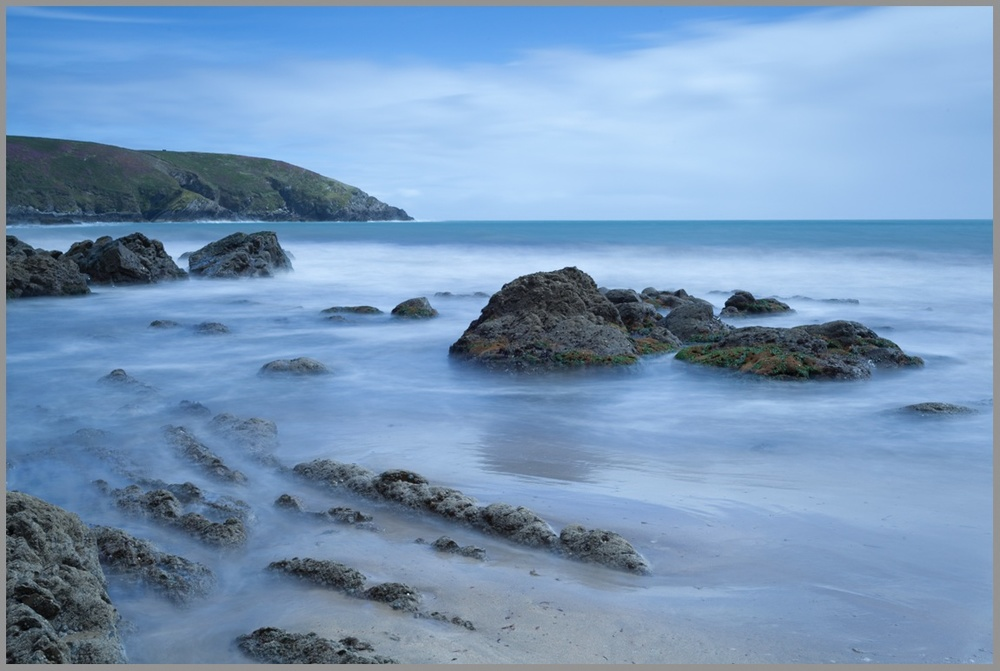 This is the RAW file of an image that was captured during the afternoon a summers day at Rocky Bay, County Cork, Ireland. As you can see the image contains a very strong blue colour cast throughout the scene and this is due to the Lee Big Stopper (10 stop ND filter)