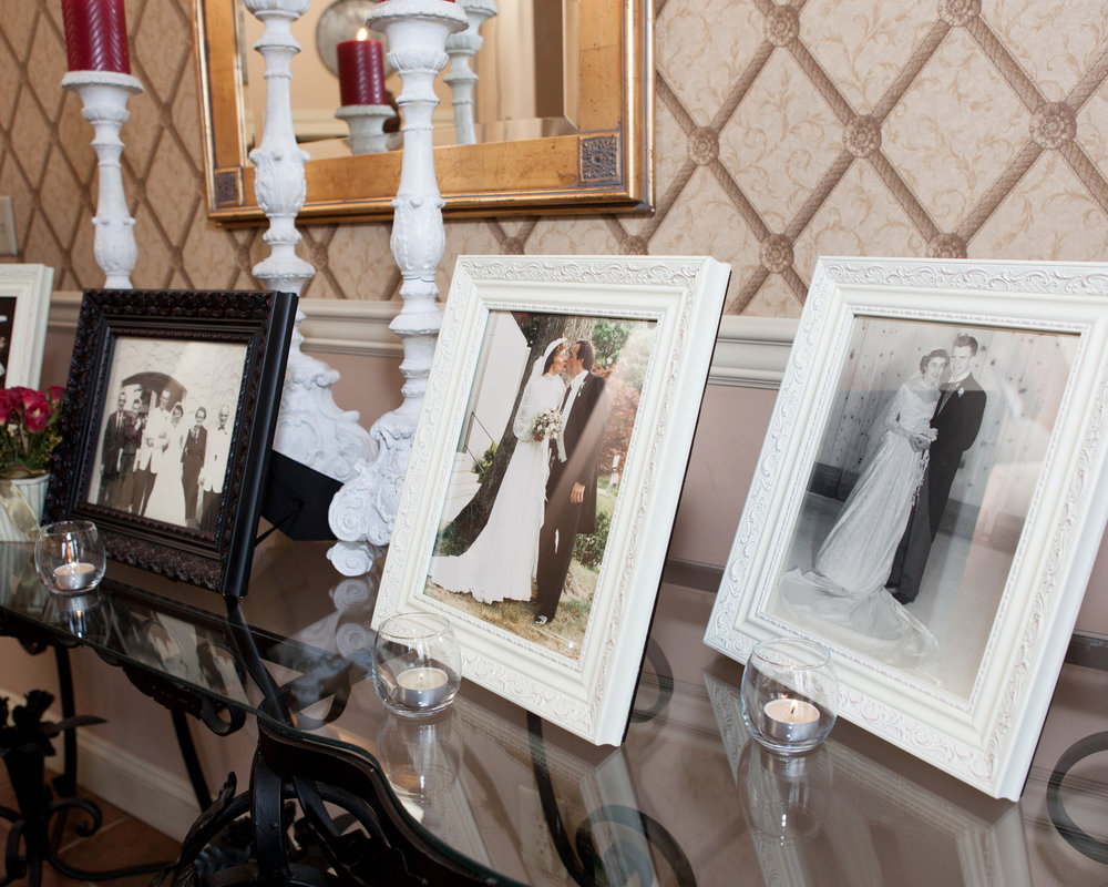framed pictures of brides and grooms family of past generations at wedding reception at the links at gettysburg in gettysburg pennsylvania.jpg